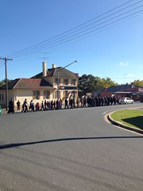 The ANZAC Day March curling its way along the main street in Tumbarumba
