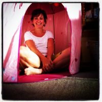 Playing in a pink princess tent