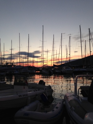 Sunset through the boats