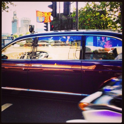 The Queen drives by