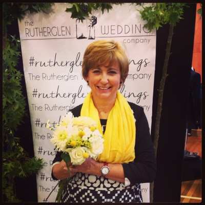 Mother of the Bride with flowers-  trial bouquets