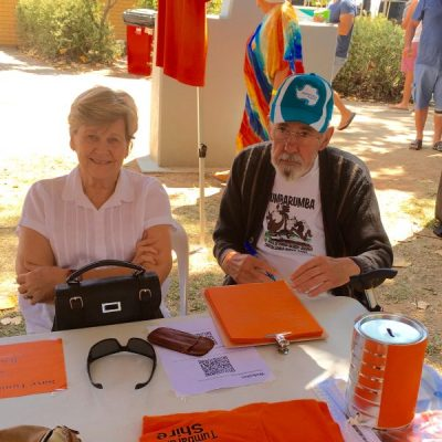 mum and dad signing the Save Tumbarumba Shire petition at Tumbafest