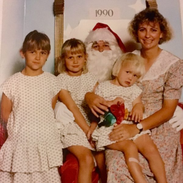 Christmas photo with girls in matching dresses