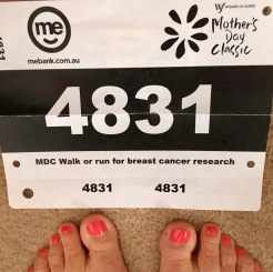 Race number and pink pedicure