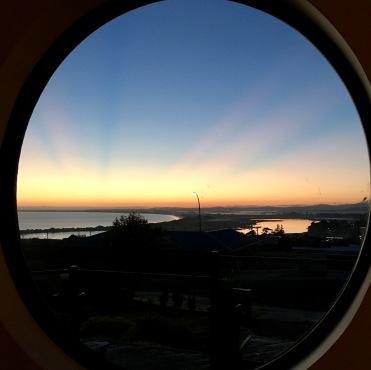 Round window at sunrise in Tasmania