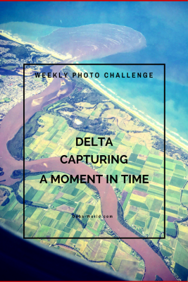 Weekly photo challenge post featuring the mouth of a river as taken from a plane for the theme of delta
