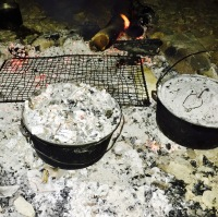 Camp ovens cook damper and billy tea cooked over the campfire in Outback Australia
