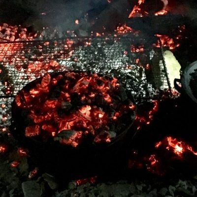 Camp oven cooking away amongst the coals