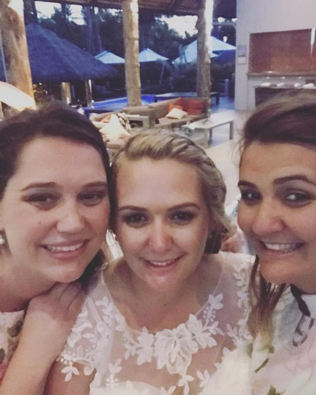 Sisters together at the wedding