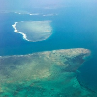 Heart shaped island below on our flight to our daughter's destination wedding in paradise