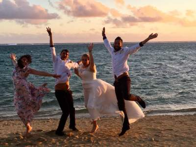 Jumping for Joy on the beach at Outrigger Resort in Fiji after Wedding