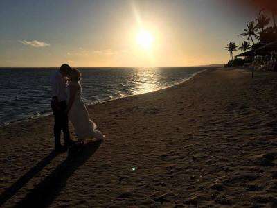 Sunset wedding photo on the beach at Outrigger Resort Fiji