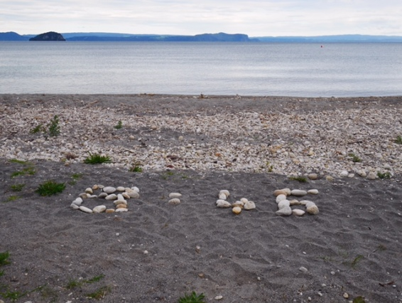 Digital time on the beach at Lake Taupo