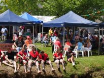 Gladiators relaxing by the creek at Tumbafest in Tumbarumba