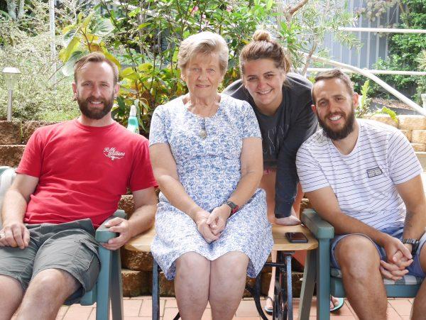 Grandma with three of her 10 grandchildren