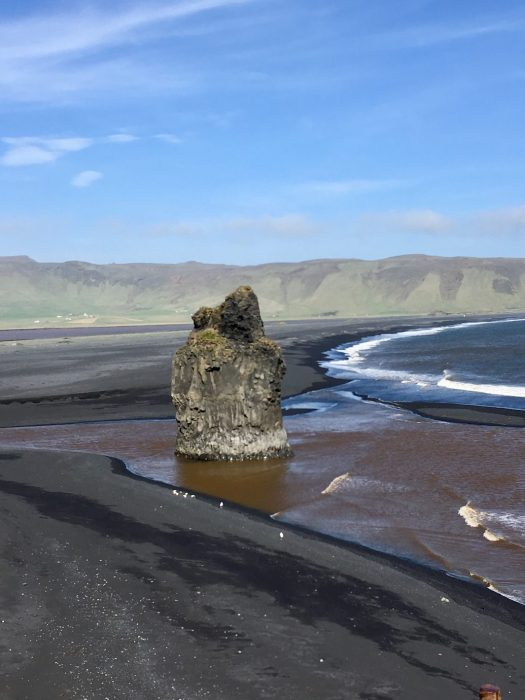 Black sandy coastline at Reynisfjara Iceland