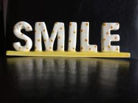 Smile it is the key that fits the lock of everybody's heart.