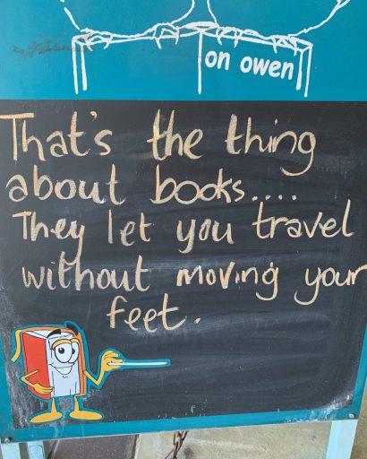 Travel sign outside a bookshop