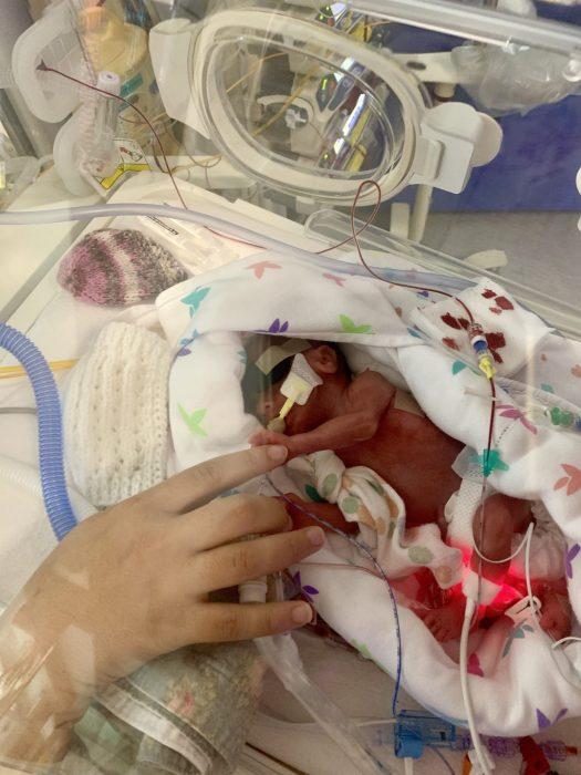 Dottie holding her mummy's finger