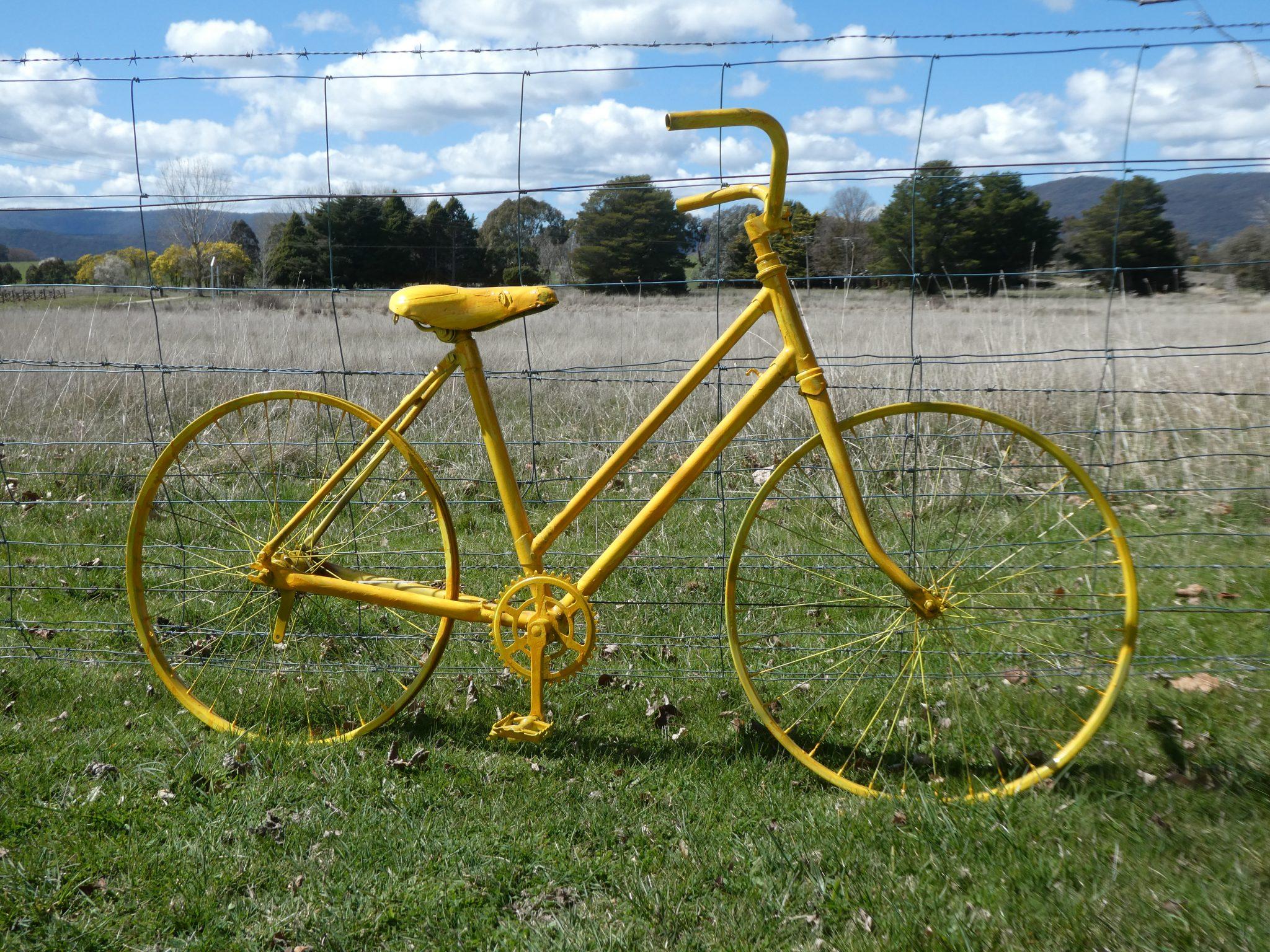 Yellow bike on fence