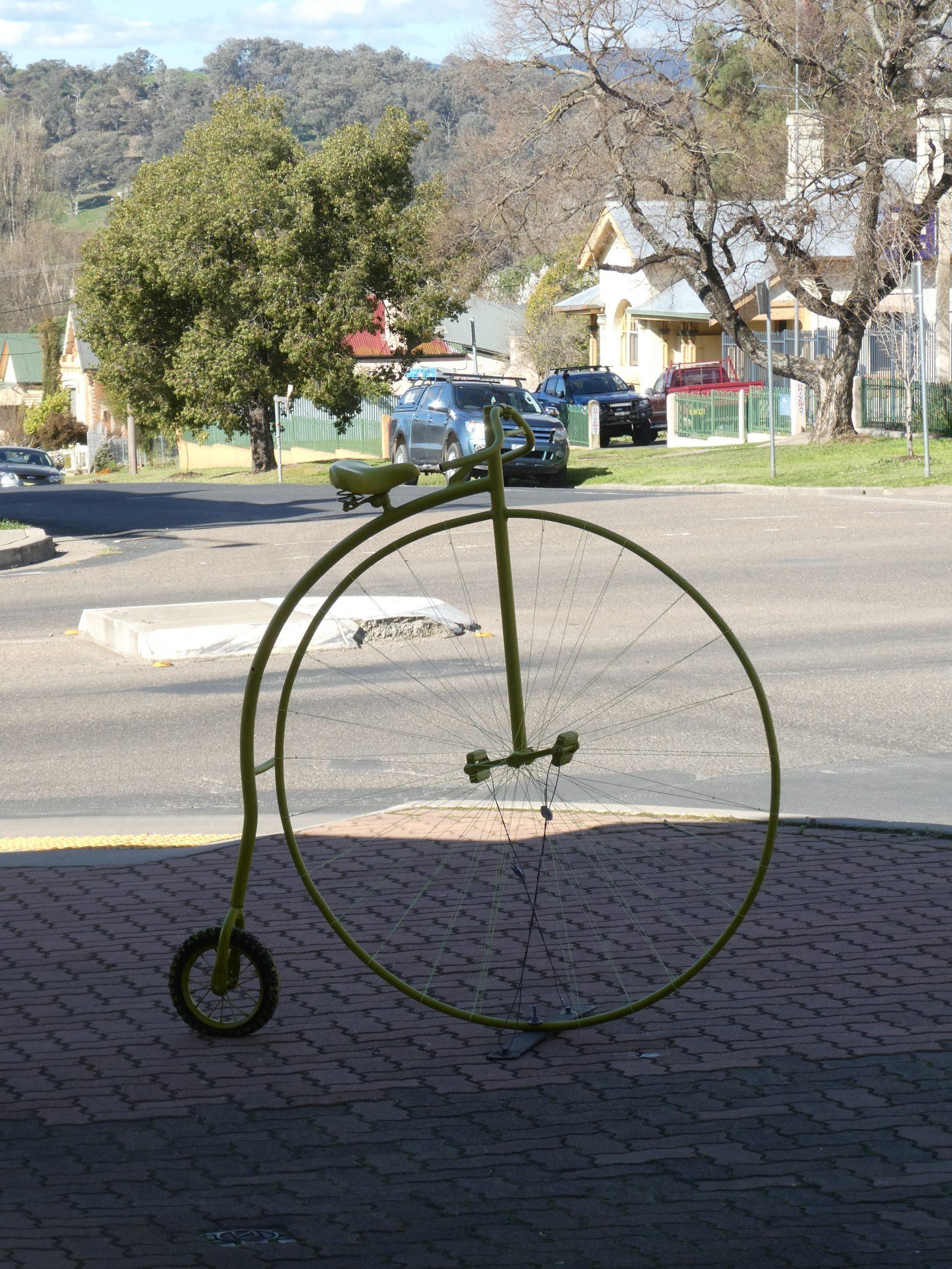Yellow penny farthing bike
