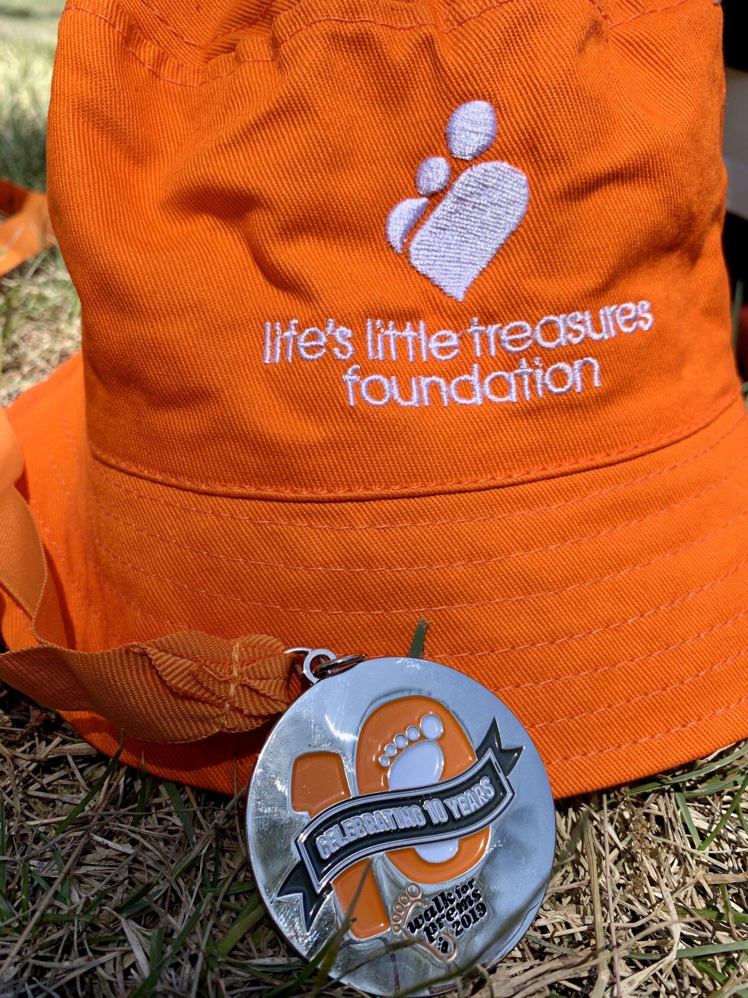 Walk for Prems hat & medal