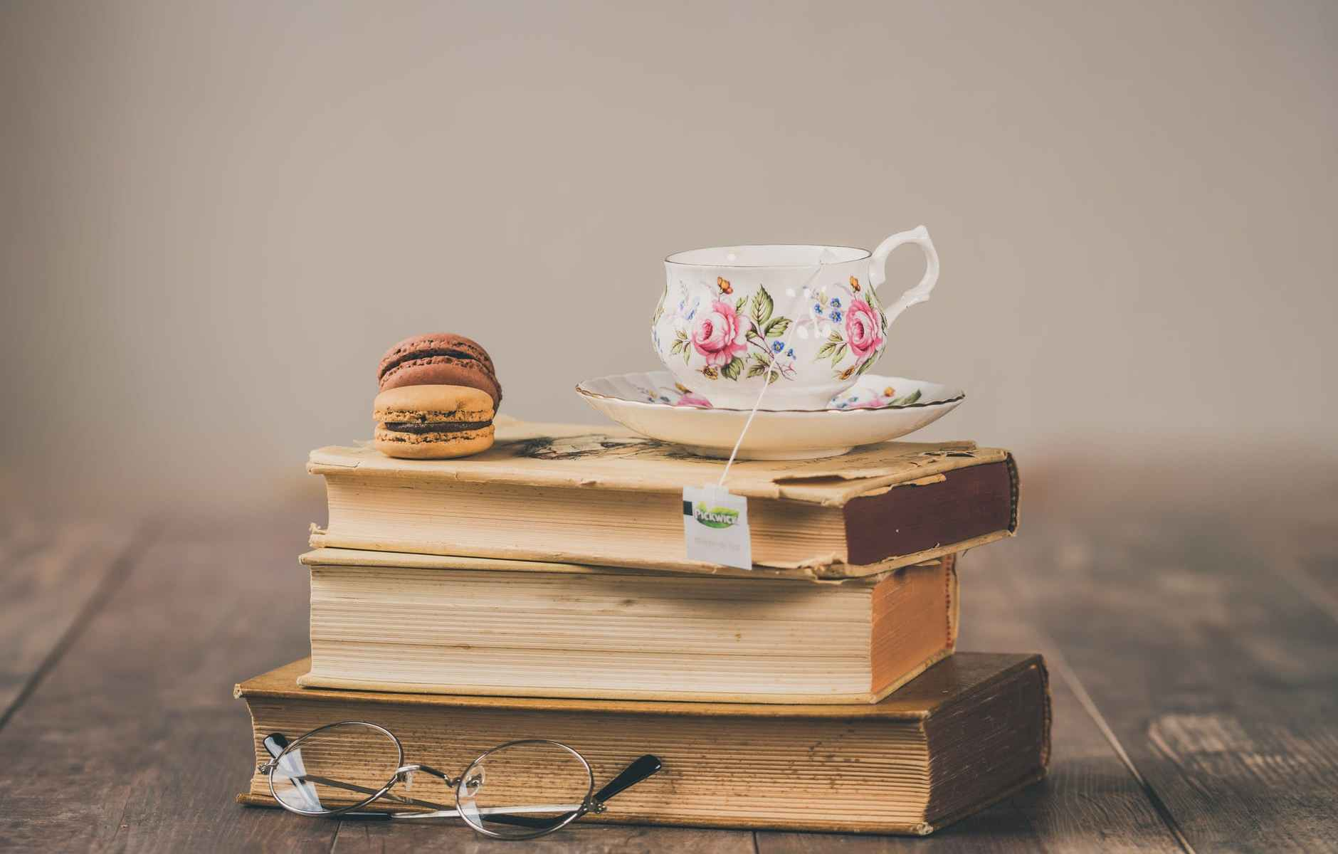photo of teacup on top of books