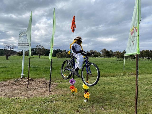 scarecrow on a bike