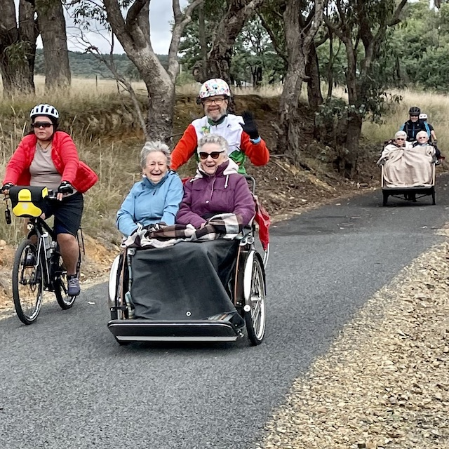 on the trail with cycling without age trikes
